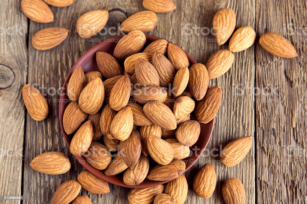 Almonds over rustic wooden background stock photo