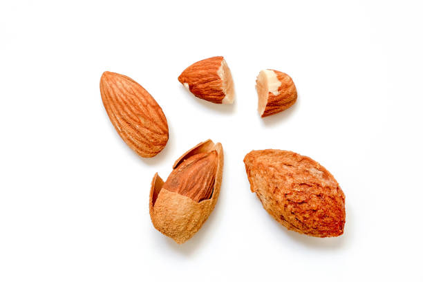 Almonds peel and cut half On a white background stock photo
