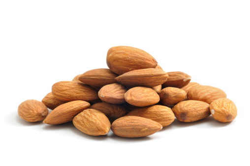 A pile of Almonds, isolated on a white background.
