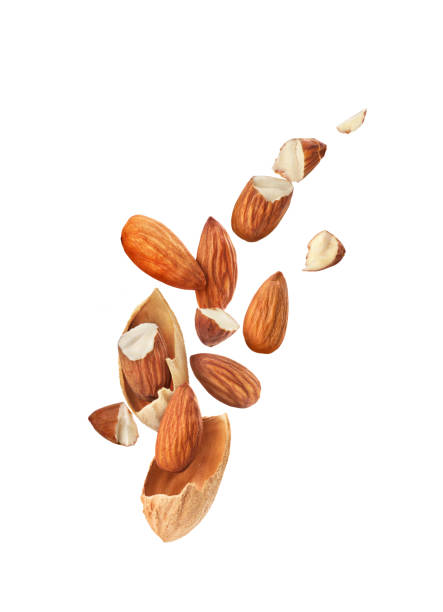 almonds slices in flight on a white background stock photo