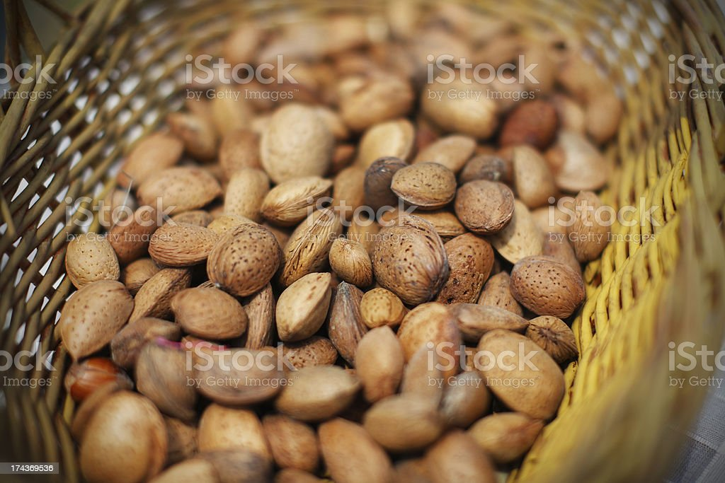 Almonds unshelled nuts in basket, fresh and raw stock photo
