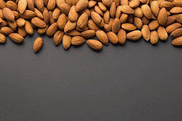 Almonds with dark copy space stock photo