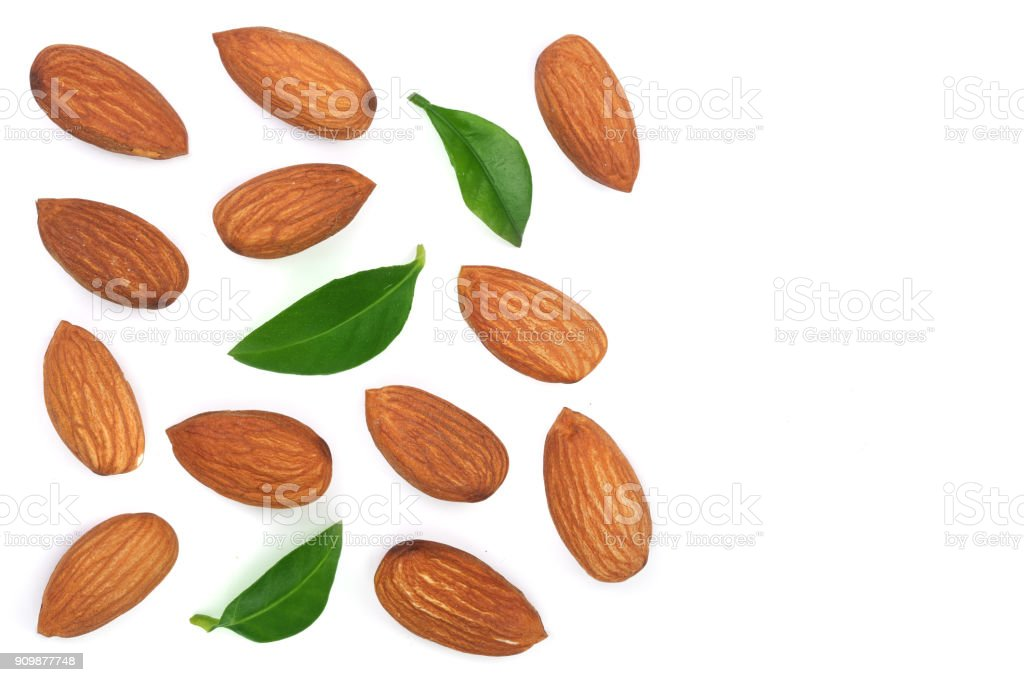 almonds with leaves isolated on white background with copy space for your text. Top view. Flat lay pattern stock photo