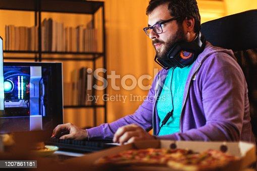 Bearded man working on his desktop computer