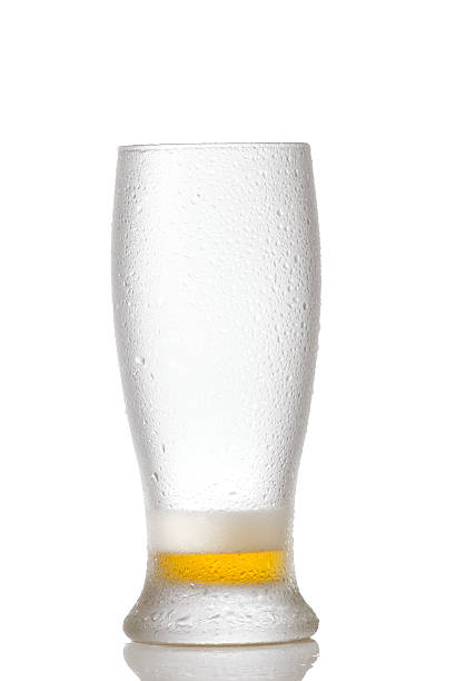 Almost empty glass of beer stock photo