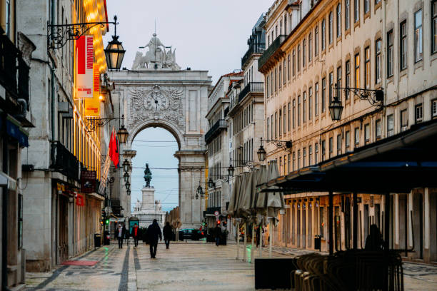 Almost empty Rua Augusta in the Baixa district of Lisbon, Portugal during Covid-19 outbreak and lockdown stock photo