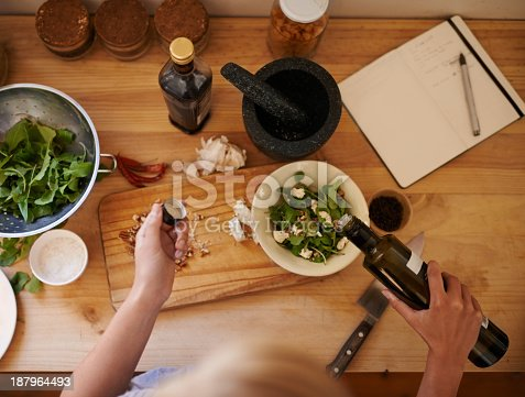 High angle shot of a woman preparing a salad in a kitchen