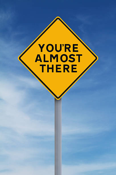 Almost There A road sign indicating You're Almost There approaching stock pictures, royalty-free photos & images