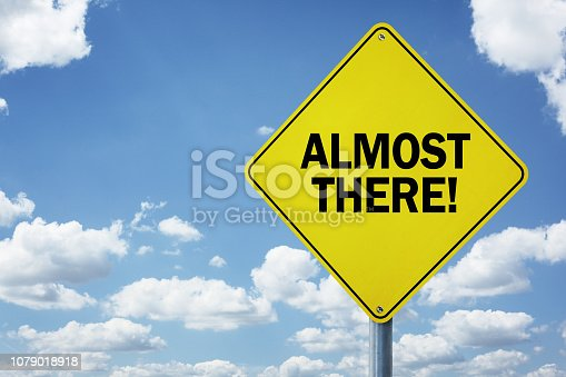 istock Almost there road sign 1079018918