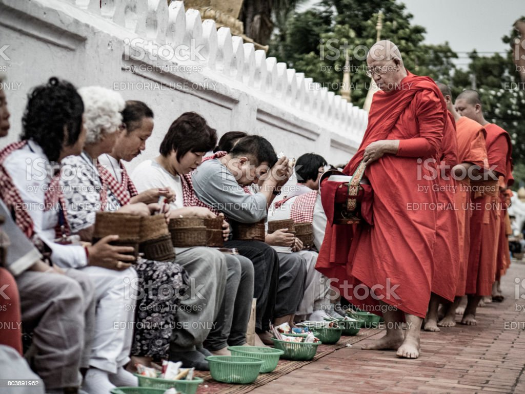 Alms giving ceremony Luang Prabang Laos stock photo