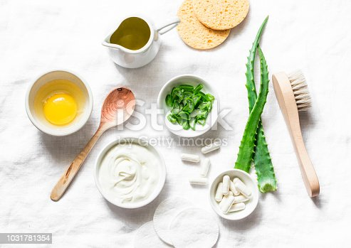 istock Aloe face mask ingredients -aloe, yogurt, egg, olive oil and beauty accessories on light background, top view. Home recipe. Flat lay 1031781354