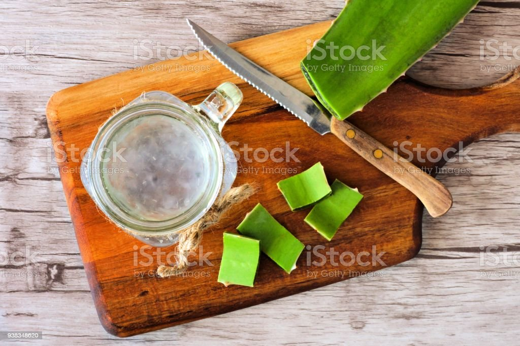 Aloe vera juice in a mason jar. Top view on a paddle board. stock photo