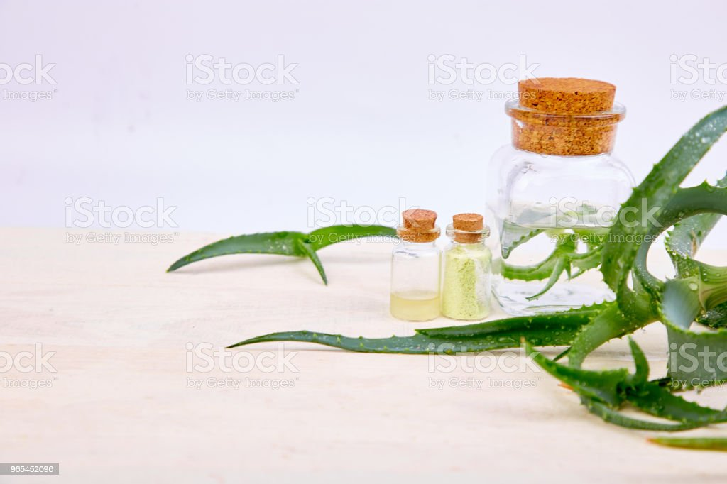 Aloe vera oil in glass bottle and towel for spa royalty-free stock photo