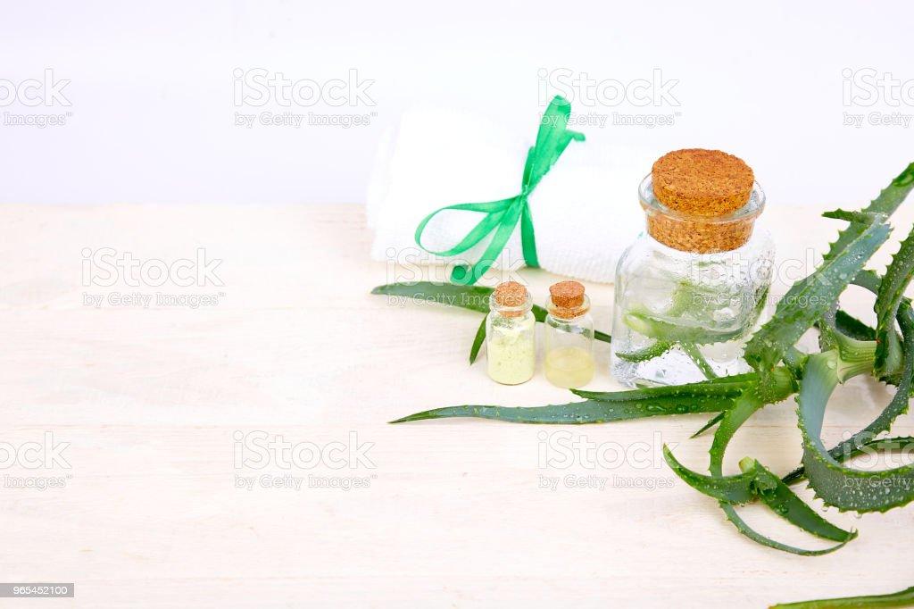 Aloe vera oil in glass bottle and towel for spa zbiór zdjęć royalty-free