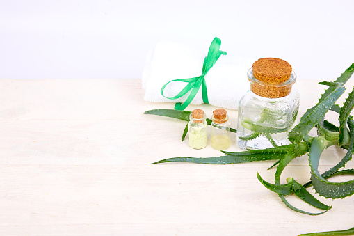 Aloe Vera Oil In Glass Bottle And Towel For Spa Stock Photo - Download Image Now