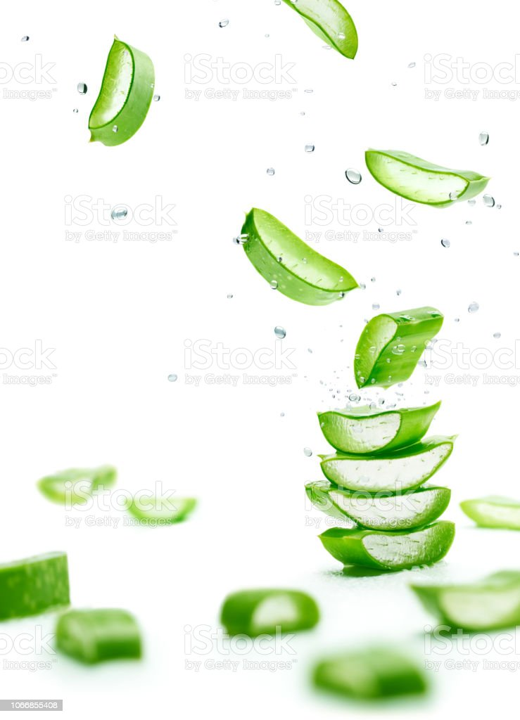 Aloe Vera slices stacked with water splash stock photo