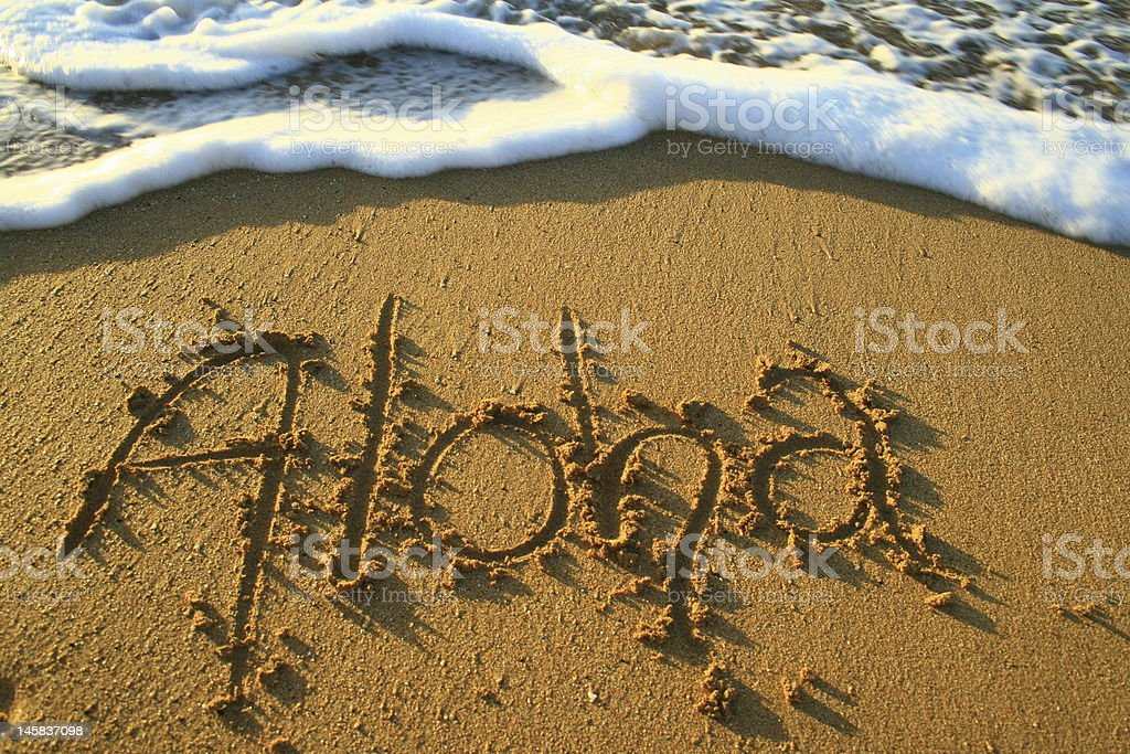 Aloha in the sand stock photo