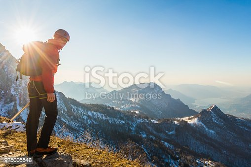 istock Alone climber lokking at mountain 925005546