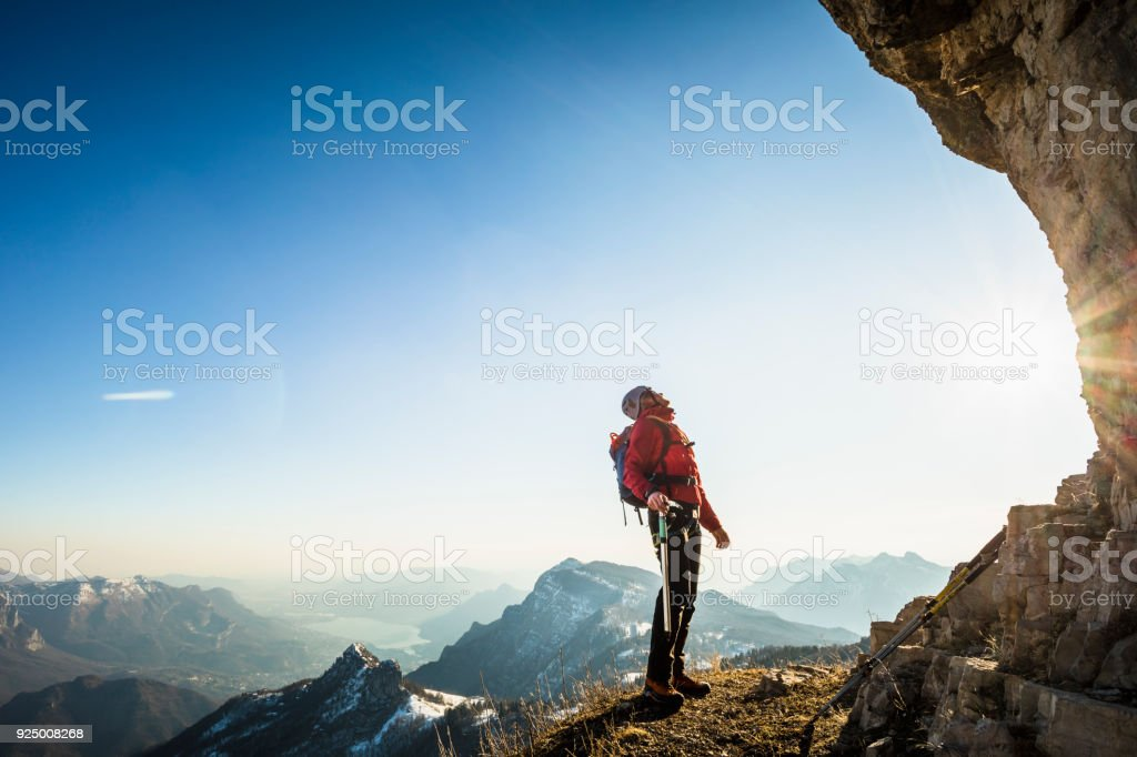 Alone climber lokking at mountain stock photo