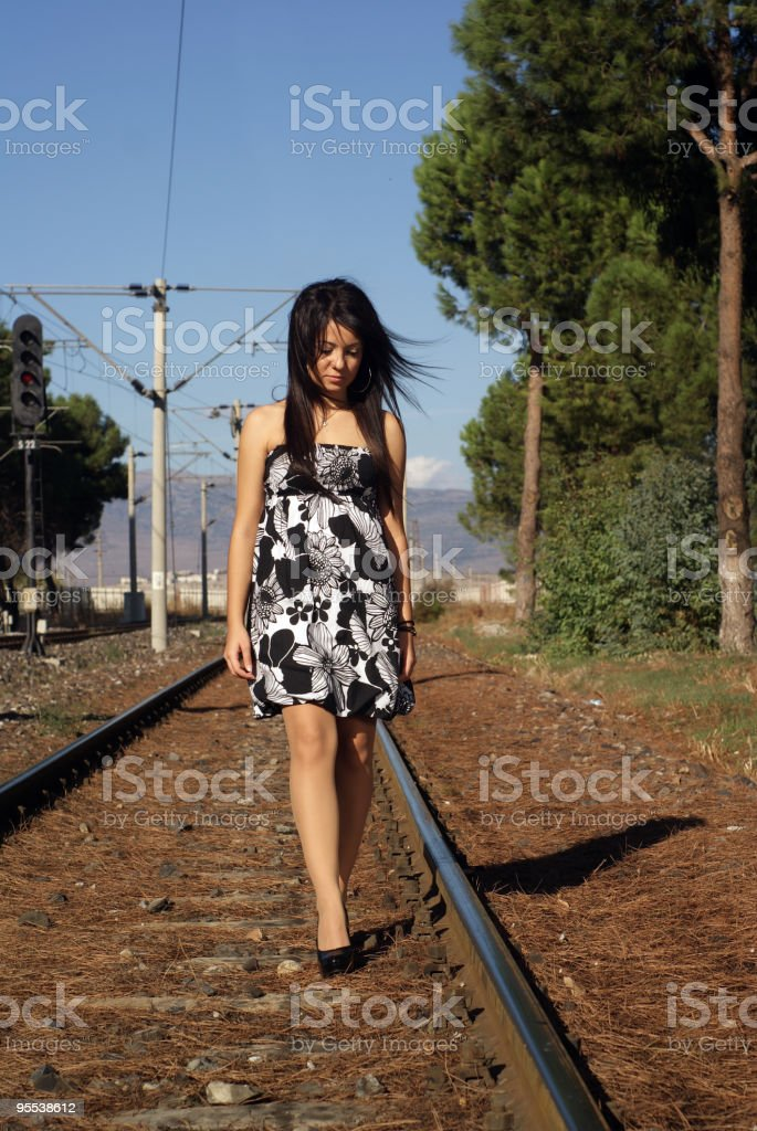 alone girl on the railroad royalty-free stock photo