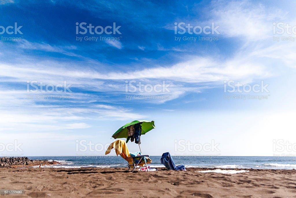Alone in the beach stock photo