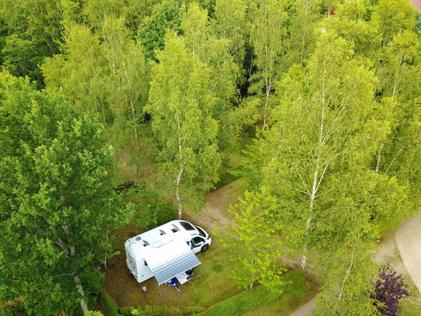 Alone on the natural campsite with RV camper van stock photo