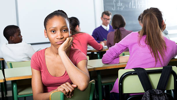 alone outcasted student being mobbed by other students - deplorable stock pictures, royalty-free photos & images
