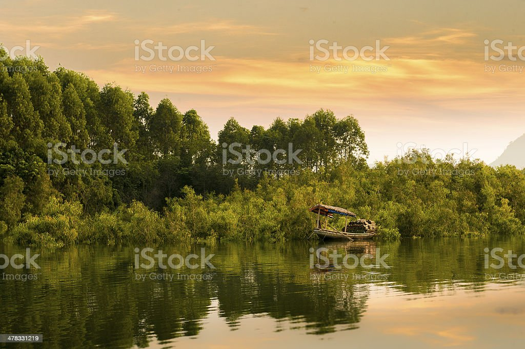 Alone rowboat on river at dusk royalty-free stock photo