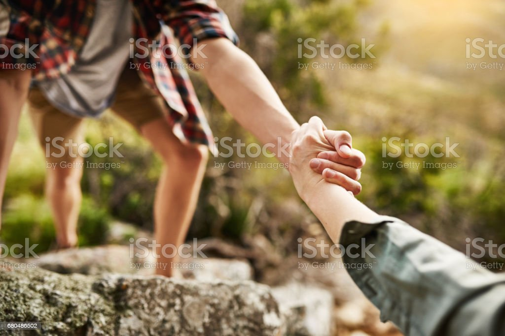 Alone we climb rocks, together we climb mountains stock photo