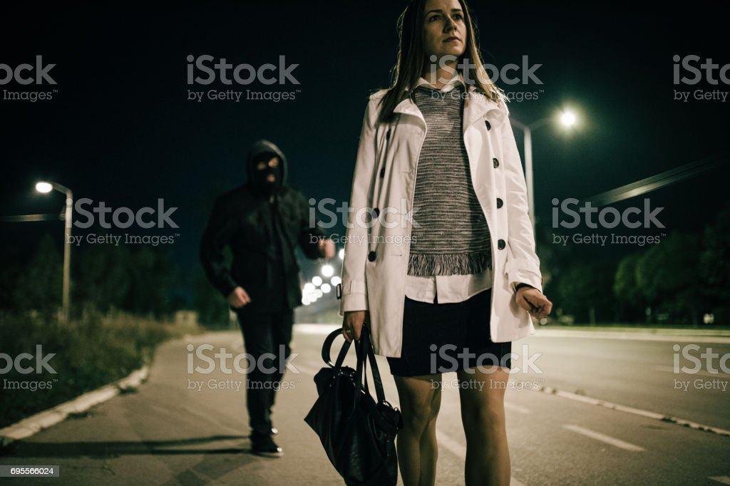Alone woman and the thief stock photo