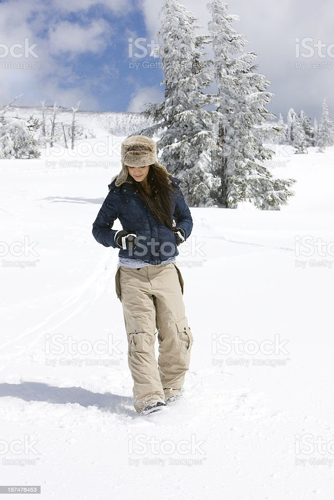 Alone Young Woman Walking on Snow Covered Mountain, Copy Space stock photo
