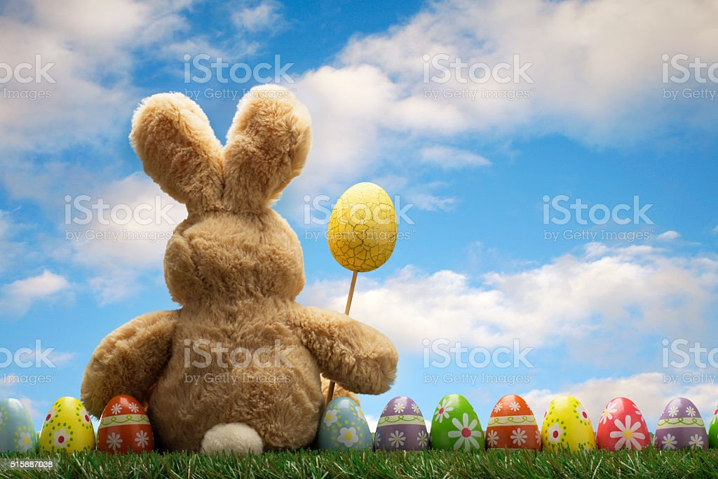 ALot of Colorful Easter Egg on Green Grass with Bunny stock photo