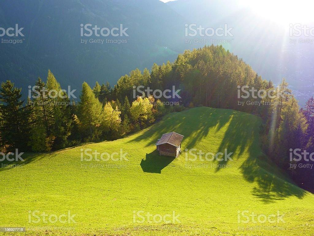 Alp hut in the fall stock photo