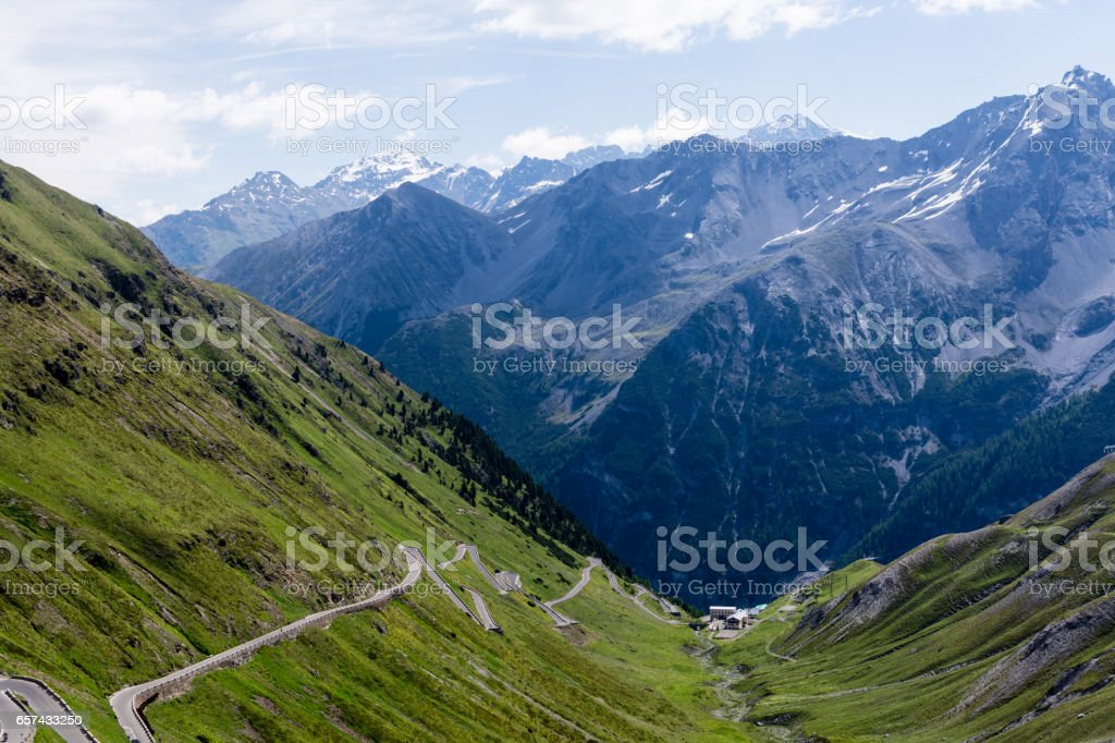 Alp road surrounded by blue alp high mountains stock photo