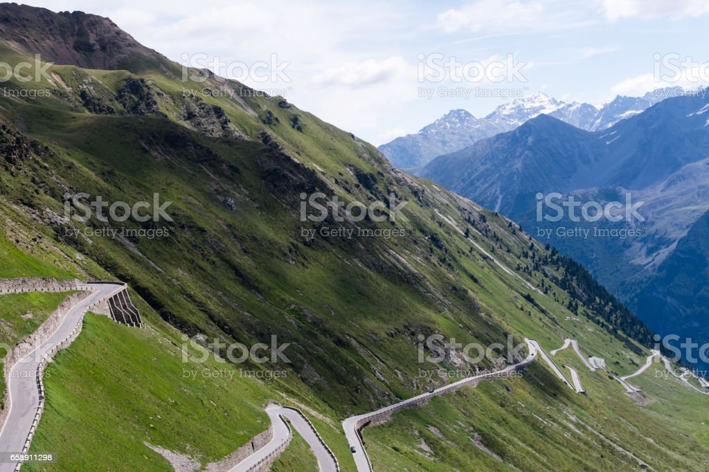 Alp road surrounded by blue alp high mountains. stock photo