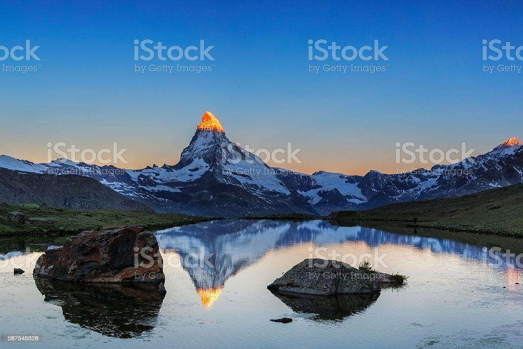 Alpen glow at Matterhorn with Stellisee in foreground stock photo