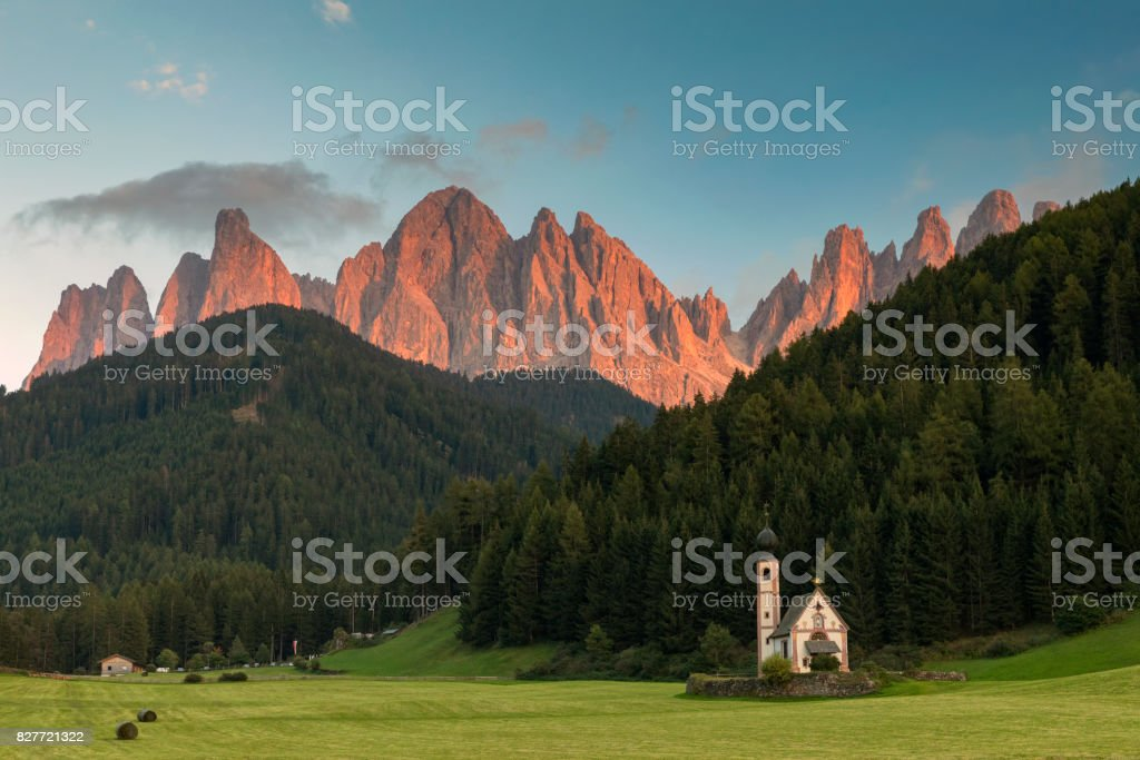 Alpenglow in Dolomites Alps - Val di Funes stock photo