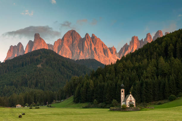Alpenglow in Dolomites Alps - Val di Funes San Giovanni Church, Dolomites, Mountain, Springtime, European Alps, Famous Place dolomites stock pictures, royalty-free photos & images