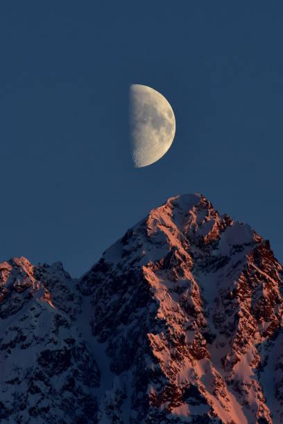 Alpenglow Moonrise stock photo