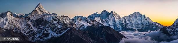 Photo of Alpenglow on dramatic mountain peaks panorama Ama Dablam Himalayas Nepal