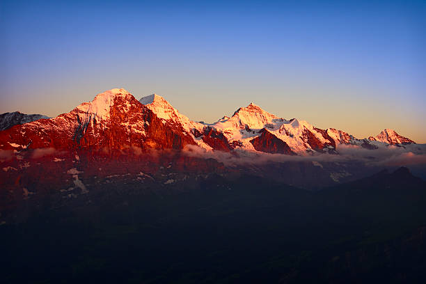 Alpengluehen Eiger mountains at sunset stock photo