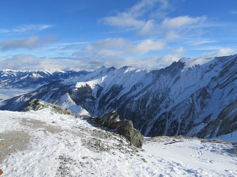 Alpes ski resort slopes, mountain panorama and sun aerial view, Austria, Austria Alps.