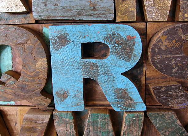 Alphabet abstract - vintage wooden letterpress types. Letter R. stock photo