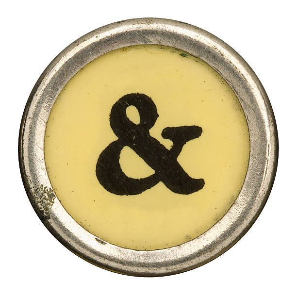 alphabet - & ampersand key from old manual typewriter. - ampersand stock pictures, royalty-free photos & images