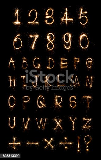istock Alphabet and Numbers sparklers on black background 893313392