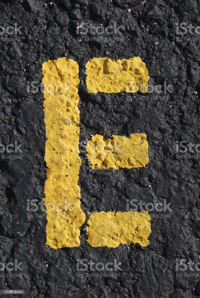 Alphabet, Asphalt Stenciled E stock photo