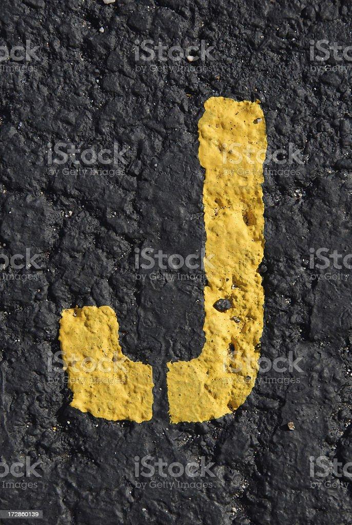 Alphabet, Asphalt Stenciled J royalty-free stock photo