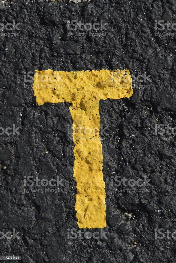 Alphabet, Asphalt Stenciled T stock photo