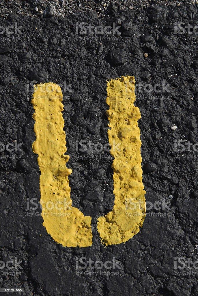 Alphabet, Asphalt Stenciled U stock photo