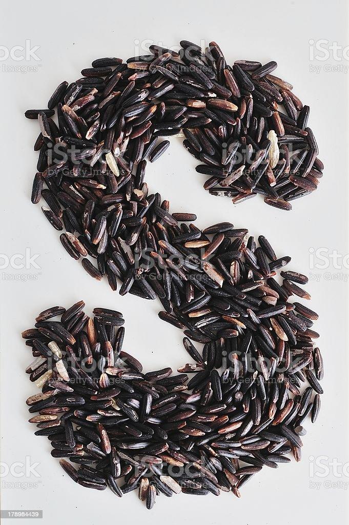 Alphabet Black rice stock photo